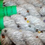 Hand spun natural angora beaded yarn.