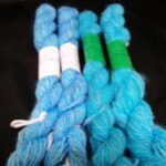 Handspun and hand dyed 100% angora yarn in turquoise blue