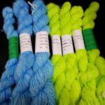 Handspun hand dyed 100% angora yarn in light blue and lemon green